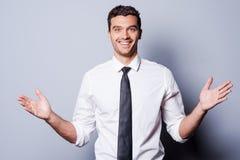 El gesticular feliz del hombre de negocios Foto de archivo
