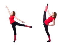 El gimnasta joven que ejercita en blanco Fotografía de archivo libre de regalías