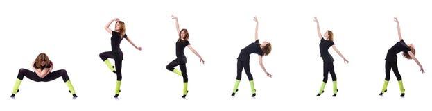 El gimnasta joven que ejercita en blanco Fotos de archivo libres de regalías