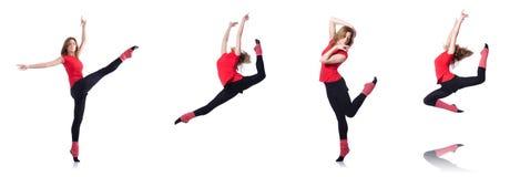 El gimnasta joven que ejercita en blanco Imágenes de archivo libres de regalías