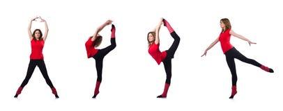 El gimnasta joven que ejercita en blanco Foto de archivo