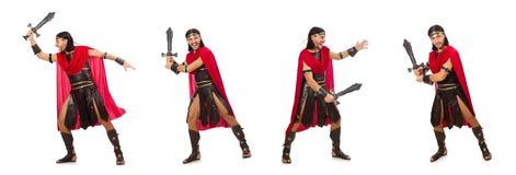 El gladiador que presenta con la espada aislada en blanco Fotos de archivo