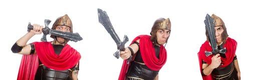 El gladiador que sostiene la espada aislada en blanco foto de archivo