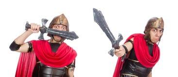 El gladiador que sostiene la espada aislada en blanco fotografía de archivo libre de regalías