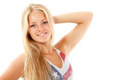 El goce alegre hermoso de la muchacha adolescente en la camiseta los E.E.U.U. señala el isolat por medio de una bandera Imagen de archivo