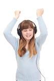 El goce de la muchacha del adolescente escucha la música Foto de archivo libre de regalías