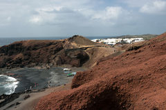 El Golfo black sand beach, Lanzarote - Canary Islands. The village of El Golfo is famous for the green lagoon and the fish restaurants, Spain royalty free stock images