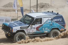 Off-road truck competing in a desert rally Stock Photography