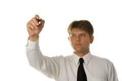 El gráfico joven del hombre de negocios en la pantalla Fotografía de archivo libre de regalías