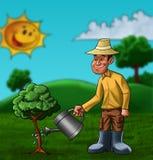 El granjero y la planta Foto de archivo libre de regalías