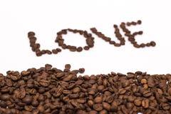 El grano de café del amor de la inscripción imágenes de archivo libres de regalías