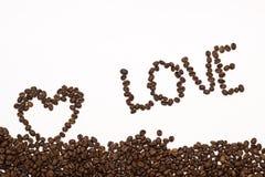 El grano de café del amor de la inscripción imagenes de archivo
