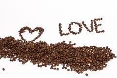 El grano de café del amor de la inscripción fotografía de archivo
