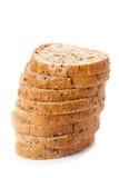 El grano entero sano cortó el pan con las semillas de girasol en b blanco Fotos de archivo