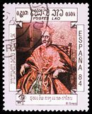 El Greco, International Stamp Exhibition ESPANA, Madrid serie, circa 1984. MOSCOW, RUSSIA - FEBRUARY 21, 2019: A stamp printed in Lao People`s Democratic stock photography