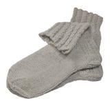 El gris caliente hizo punto los calcetines de lana, primer macro aislado detallado grande, detalle gris de los pares de la mezcla Imagen de archivo libre de regalías