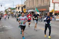 El Grito 5K. Chicago, Illinois , USA - September 9, 2018, El Grito 5K at la Villita, family run walk, men and women running in the annual 5 kilometers race stock photo