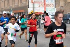 El Grito 5K. Chicago, Illinois , USA - September 9, 2018, El Grito 5K at la Villita, family run walk, men and women running in the annual 5 kilometers race stock photography