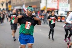 El Grito 5K. Chicago, Illinois , USA - September 9, 2018, El Grito 5K at la Villita, family run walk, men and women running in the annual 5 kilometers race stock photos