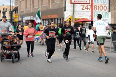 El Grito 5K. Chicago, Illinois , USA - September 9, 2018, El Grito 5K at la Villita, family run walk, men and women running in the annual 5 kilometers race royalty free stock photography