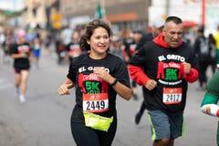 El Grito 5K. Chicago, Illinois , USA - September 9, 2018, El Grito 5K at la Villita, family run walk, men and women running in the annual 5 kilometers race stock images