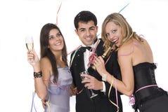 El grupo de amigos en Años Nuevos party Fotos de archivo libres de regalías