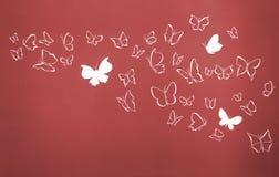 El fondo del blanco siluetea volar de las mariposas Fotografía de archivo libre de regalías