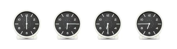 El grupo del primer de reloj blanco y negro con la sombra para adorna la demostración el tiempo en 6, 6:15, 6:30, 6:45 a M Aislad Fotografía de archivo