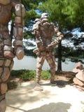 El guarda de la roca con el arma Fotos de archivo