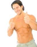 El guiño caucásico masculino y da los pulgares para arriba Fotografía de archivo libre de regalías