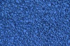 El guijarro ultra azul texturizó el contexto y el fondo superficiales, de piedra del canto rodado imagen de archivo libre de regalías