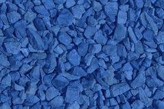 El guijarro ultra azul texturizó el contexto y el fondo superficiales, de piedra del canto rodado foto de archivo libre de regalías