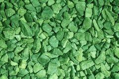 El guijarro ultra verde texturizó el contexto y el fondo superficiales, de piedra del canto rodado fotografía de archivo