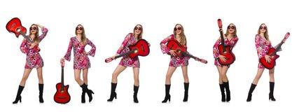El guitarrista de la mujer imagen de archivo libre de regalías