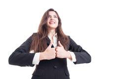 El héroe tiró de la mujer de negocios que mostraba el doble como gesto Fotos de archivo libres de regalías