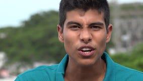 El hablar adolescente emocionado o enojado del muchacho Foto de archivo libre de regalías