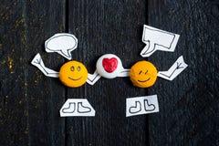 El hablar de la cara de dos sonrisas Imagen de archivo libre de regalías