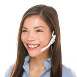 El hablar de la mujer del servicio de atención al cliente de las auriculares amistoso fotografía de archivo libre de regalías