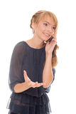 El hablar emocional de la muchacha adolescente en el teléfono móvil Fotografía de archivo