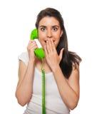 El hablar femenino joven en el teléfono Foto de archivo libre de regalías