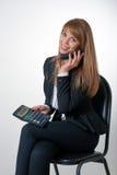 El hablar femenino joven por el teléfono Imagen de archivo libre de regalías