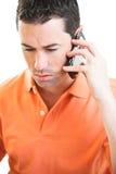 El hablar masculino triste en el teléfono móvil foto de archivo libre de regalías