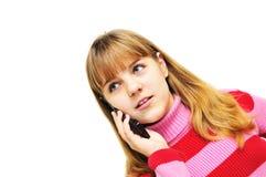 El hablar por el teléfono móvil Imagenes de archivo