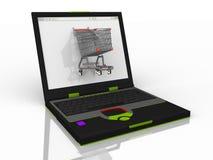 El hacer compras en su ordenador Imagenes de archivo