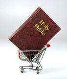 El hacer compras para la religión Foto de archivo