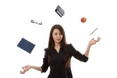 El hacer juegos malabares de la mujer Imagen de archivo