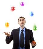 El hacer juegos malabares del hombre de negocios Imagen de archivo libre de regalías