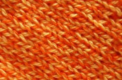 El hacer punto anaranjado imagen de archivo