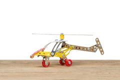 El helicóptero del metal del juguete en blanco Imágenes de archivo libres de regalías