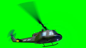 El helicóptero UH-1 vuela en la pantalla verde almacen de metraje de vídeo